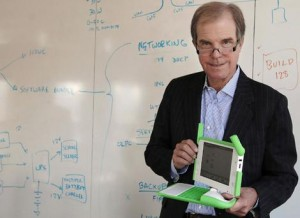 Nicholas Negroponte of the One Laptop Per Child project with one of the XO laptops. Photo: AP